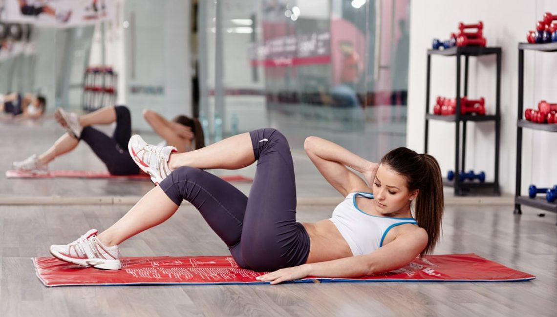 Woman Working Out Abs Crunches